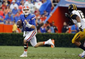 Oct 15, 2016; Gainesville, FL, USA; Florida Gators quarterback Luke Del Rio (14) runs out of pocket against the Missouri Tigers during the second half at Ben Hill Griffin Stadium. The Gators won 40-14. Mandatory Credit: Kim Klement-USA TODAY Sports