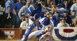Oct 15, 2016; Chicago, IL, USA; Chicago Cubs infielder Javier Baez (bottom) steals home ahead of the tag by Los Angeles Dodgers catcher Carlos Ruiz (51) during the second inning in game one of the 2016 NLCS playoff baseball series at Wrigley Field. Mandatory Credit: Jerry Lai-USA TODAY Sports