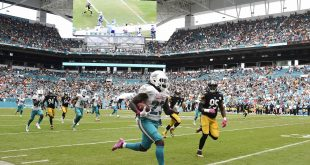 Miami Dolphins running back Jay Ajayi (23) runs past Pittsburgh Steelers outside linebacker Jarvis Jones (95) for a touchdown during the second half at Hard Rock Stadium. The Dolphins won 30-15. Steve Mitchell-USA TODAY Sports