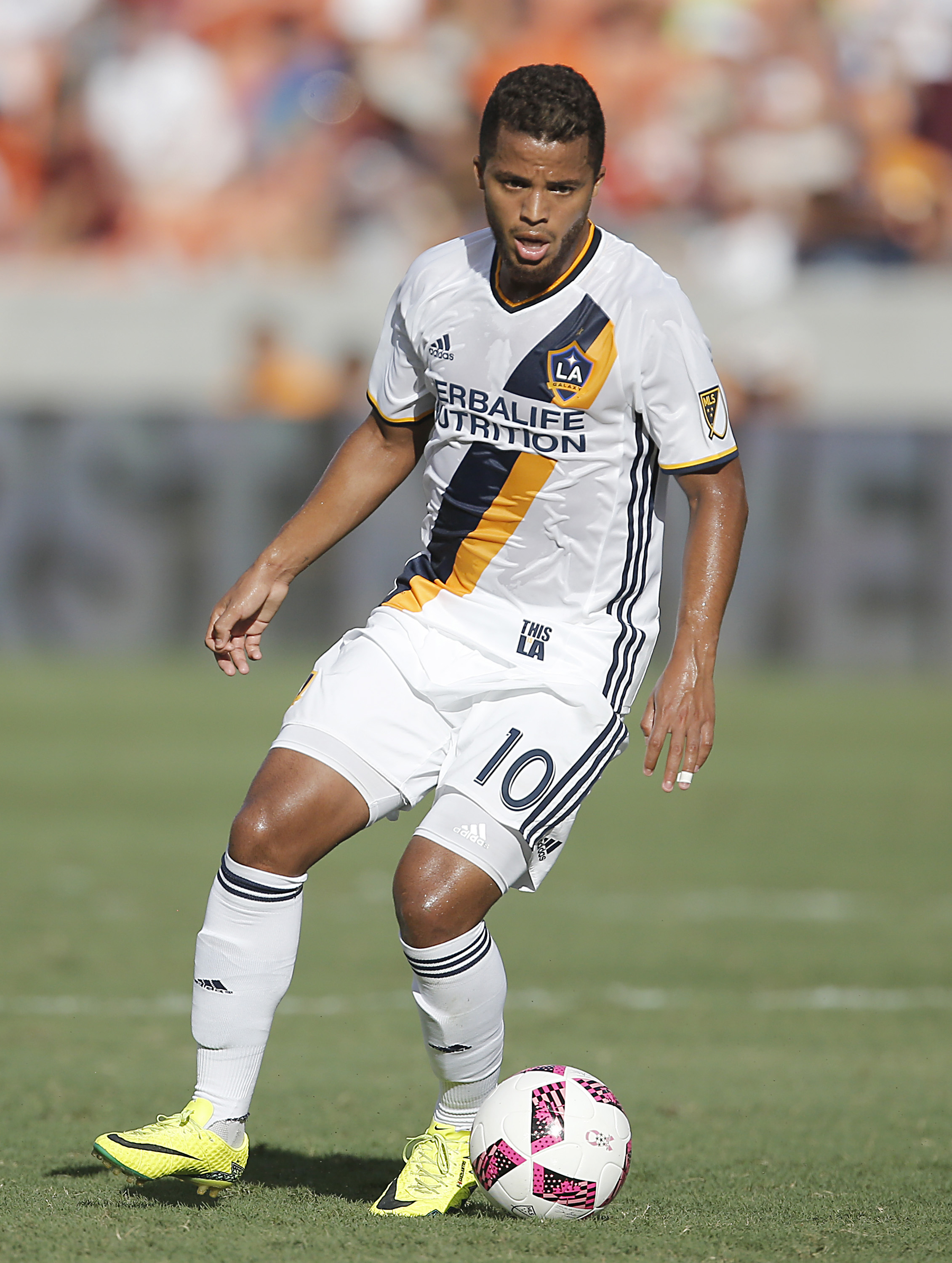 Oct 16, 2016; Houston, TX, USA; Los Angeles Galaxy forward Giovani dos Santos (10) dribbles against the Houston Dynamo in the first half at BBVA Compass Stadium. Mandatory Credit: Thomas B. Shea-USA TODAY Sports