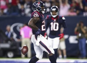 Oct 16, 2016; Houston, TX, USA; Houston Texans running back Lamar Miller (26) scores a touchdown during the fourth quarter against the Indianapolis Colts at NRG Stadium. The Texans won 26-23 in overtime. Mandatory Credit: Troy Taormina-USA TODAY Sports