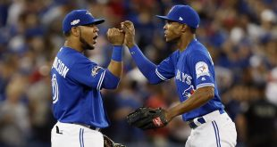 Oct 18, 2016; Toronto, Ontario, CAN; Toronto Blue Jays first baseman Edwin Encarnacion (10) and left fielder Melvin Upton Jr. (7) celebrate beating the Cleveland Indians in game four of the 2016 ALCS playoff baseball series at Rogers Centre. Mandatory Credit: John E. Sokolowski-USA TODAY Sports