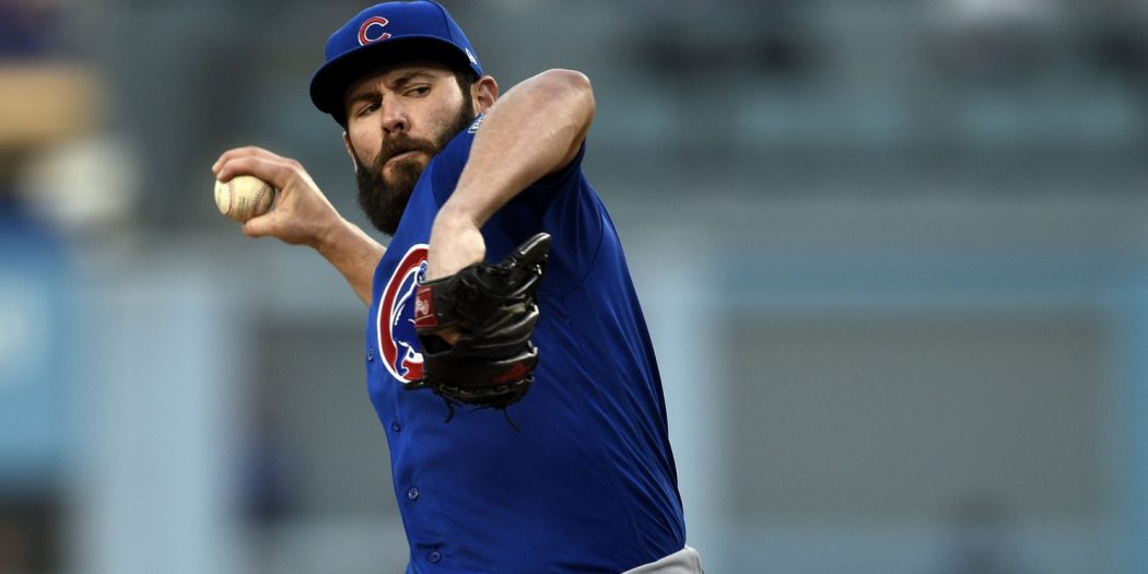 Oct 18, 2016; Los Angeles, CA, USA; Chicago Cubs starting pitcher Jake Arrieta (49) pitches during the second inning against the Los Angeles Dodgers in game three of the 2016 NLCS playoff baseball series at Dodger Stadium. Mandatory Credit: Kelvin Kuo-USA TODAY Sports