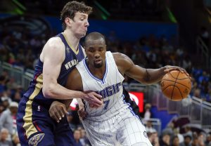 Oct 20, 2016; Orlando, FL, USA; Orlando Magic forward Serge Ibaka (7) drives past New Orleans Pelicans center Omer Asik (3) during the third quarter of a basketball game at Amway Center. Mandatory Credit: Reinhold Matay-USA TODAY Sports