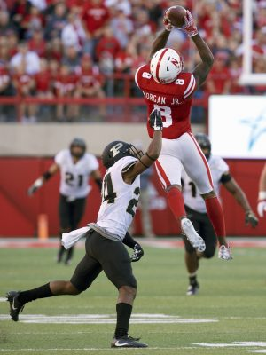 Oct 22, 2016; Lincoln, NE, USA; Nebraska Cornhuskers wide receiver Stanley Morgan Jr. (8) catches a pass defended by Purdue Boilermakers cornerback Tim Cason (24) in the second half at Memorial Stadium. Nebraska won 27-14. Mandatory Credit: Bruce Thorson-USA TODAY Sports