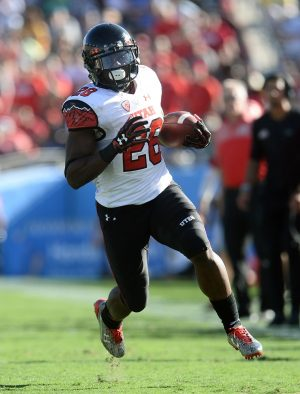 October 22, 2016; Pasadena, CA, USA; Utah Utes running back Joe Williams (28) runs the ball against the UCLA Bruins during the second half at the Rose Bowl. Mandatory Credit: Gary A. Vasquez-USA TODAY Sports