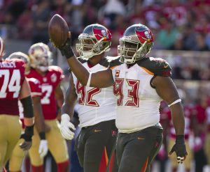 Oct 23, 2016; Santa Clara, CA, USA; Tampa Bay Buccaneers defensive tackle Gerald McCoy (93) holds the ball after a fumble recovery against the San Francisco 49ers during the third quarter at Levi's Stadium. The Tampa Bay Buccaneers defeated the San Francisco 49ers 34-17. Mandatory Credit: Kelley L Cox-USA TODAY Sports