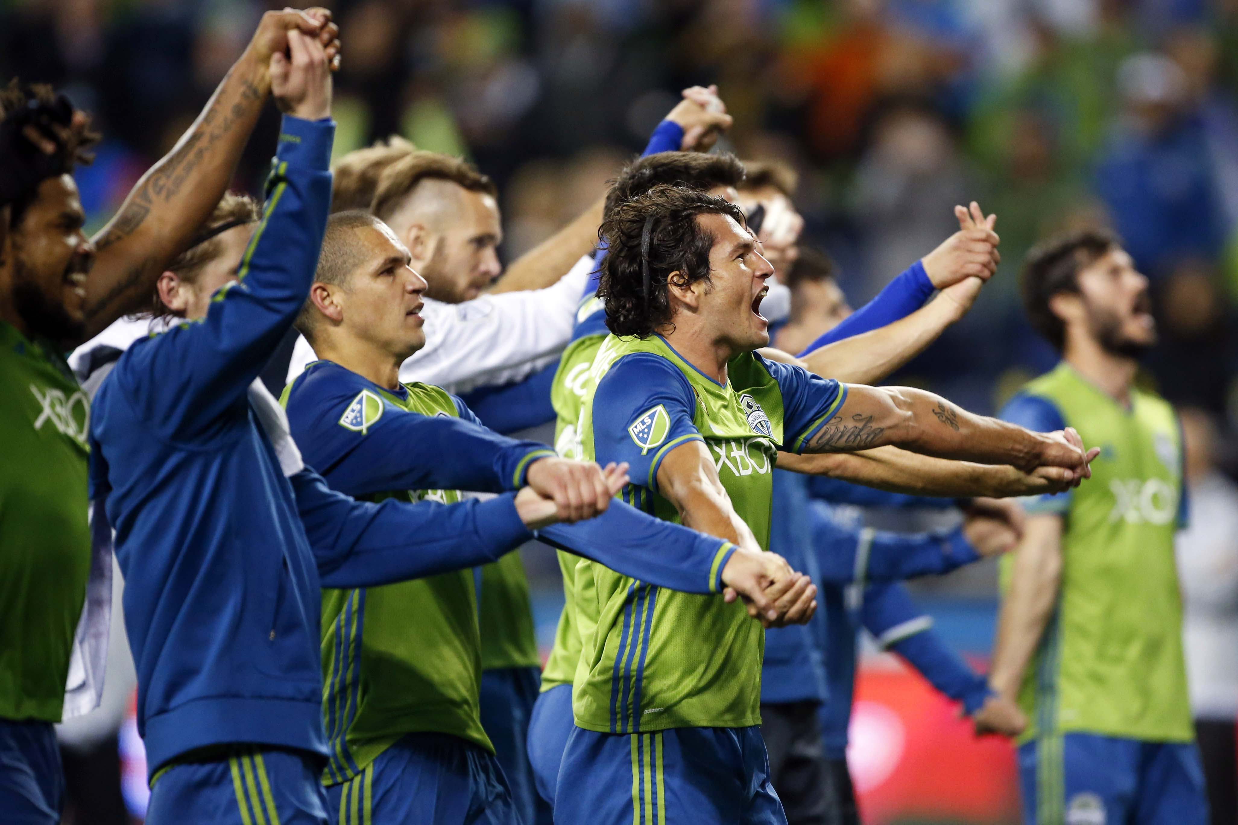 Oct 27, 2016; Seattle, WA, USA; Seattle Sounders FC forward Nelson Valdez (16) celebrates with his teammates after a 1-0 victory against Sporting Kansas City at CenturyLink Center. Mandatory Credit: Jennifer Buchanan-USA TODAY Sports