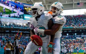 Oct 9, 2016; Miami Gardens, FL, USA; Miami Dolphins wide receiver Leonte Carroo (right) celebrates Dolphins wide receiver Jakeem Grant (left) touchdown run during the first half against Tennessee Titans at Hard Rock Stadium. Mandatory Credit: Steve Mitchell-USA TODAY Sports