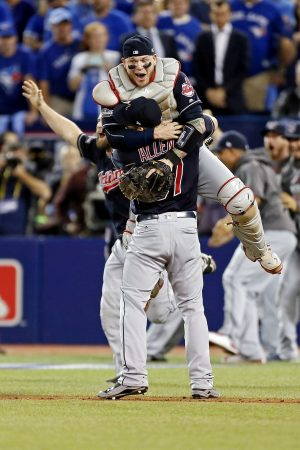 Oct 19, 2016; Toronto, Ontario, CAN; Cleveland Indians catcher Roberto Perez (55) and relief pitcher Cody Allen (37) celebrate beating the Toronto Blue Jays in game five of the 2016 ALCS playoff baseball series at Rogers Centre. Mandatory Credit: John E. Sokolowski-USA TODAY Sports