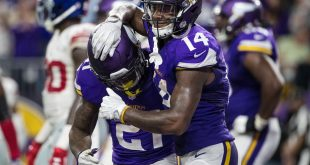 Oct 3, 2016; Minneapolis, MN, USA; Minnesota Vikings running back Jerick McKinnon (21) celebrates his touchdown with wide receiver Stefon Diggs (14) during the fourth quarter against the New York Giants at U.S. Bank Stadium. The Vikings defeated the Giants 24-10. Mandatory Credit: Brace Hemmelgarn-USA TODAY Sports