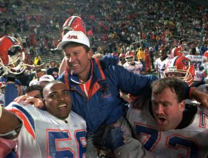 Florida Gators head coach Steve Spurrier is carried on the field by Cameron Davis, 56, and Jim Watson, 73, after the Gators Downed the Alabama Crimson tide 28-3 in the 1993 SEC Football Championship in Birmingham, Ala., Dec.4, 1993. (AP photo/Dave Martin)