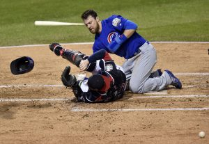 Nov 1, 2016; Cleveland, OH, USA; Chicago Cubs outfielder Ben Zobrist (18) scores a run past Cleveland Indians catcher Roberto Perez (55) in the first inning in game six of the 2016 World Series at Progressive Field. Mandatory Credit: David Richard-USA TODAY Sports