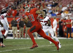 Nov 3, 2016; Tampa, FL, USA; Tampa Bay Buccaneers wide receiver Mike Evans (13) runs with the ball against the Atlanta Falcons during the second half at Raymond James Stadium. Atlanta Falcons defeated the Tampa Bay Buccaneers 43-28. Mandatory Credit: Kim Klement-USA TODAY Sports