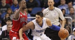 Mar 2, 2016; Orlando, FL, USA; Orlando Magic center Nikola Vucevic (9) drives into Chicago Bulls forward Bobby Portis (5) during the second half of a basketball game at Amway Center. The Magic won 102-89. Mandatory Credit: Reinhold Matay-USA TODAY Sports
