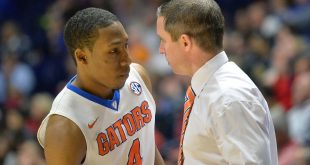 Mar 10, 2016; Nashville, TN, USA; Florida Gators head coach Mike White talks with Gators guard KeVaughn Allen (4) during the second half of the second game of the SEC tournament against the Arkansas Razorbacks at Bridgestone Arena. Mandatory Credit: Jim Brown-USA TODAY Sports