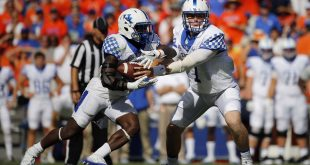 Sep 10, 2016; Gainesville, FL, USA;Kentucky Wildcats quarterback Drew Barker (7) hands the ball off to Kentucky Wildcats running back Stanley Boom Williams (18) during the first half at Ben Hill Griffin Stadium. Mandatory Credit: Kim Klement-USA TODAY Sports