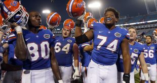 Oct 29, 2016; Jacksonville, FL, USA; Florida Gators offensive lineman Fred Johnson (74), Florida Gators tight end C'yontai Lewis (80) and teammates celebrate after they beat the Georgia Bulldogs at EverBank Field. Florida Gators defeated the Georgia Bulldogs 24-10. Mandatory Credit: Kim Klement-USA TODAY Sports