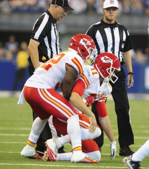 Oct 30, 2016; Indianapolis, IN, USA; Kansas City Chiefs quarterback Alex Smith (11) is helped up by teammate running back Spencer Ware (32) after taking a hard hit in the first half from Indianapolis Colts linebacker Edwin Jackson (53) at Lucas Oil Stadium. Mandatory Credit: Thomas J. Russo-USA TODAY Sports
