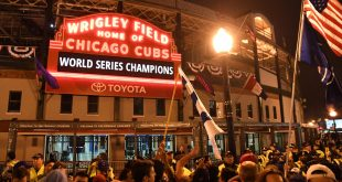 Nov 2, 2016; Cleveland, OH, USA; Chicago Cubs fans celebrate after game seven of the 2016 World Series against the Cleveland Indians outside of Wrigley Field. Cubs won 8-7. Mandatory Credit: Patrick Gorski-USA TODAY Sports