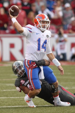Nov 5, 2016; Fayetteville, AR, USA; Florida Gators quarterback Luke Del Rio (14) is tackled as he releases the ball by Arkansas Razorbacks defensive lineman Deatrich Wise Jr. (48) at Donald W. Reynolds Razorback Stadium. Arkansas defeated Florida 31-10. Mandatory Credit: Nelson Chenault-USA TODAY Sports