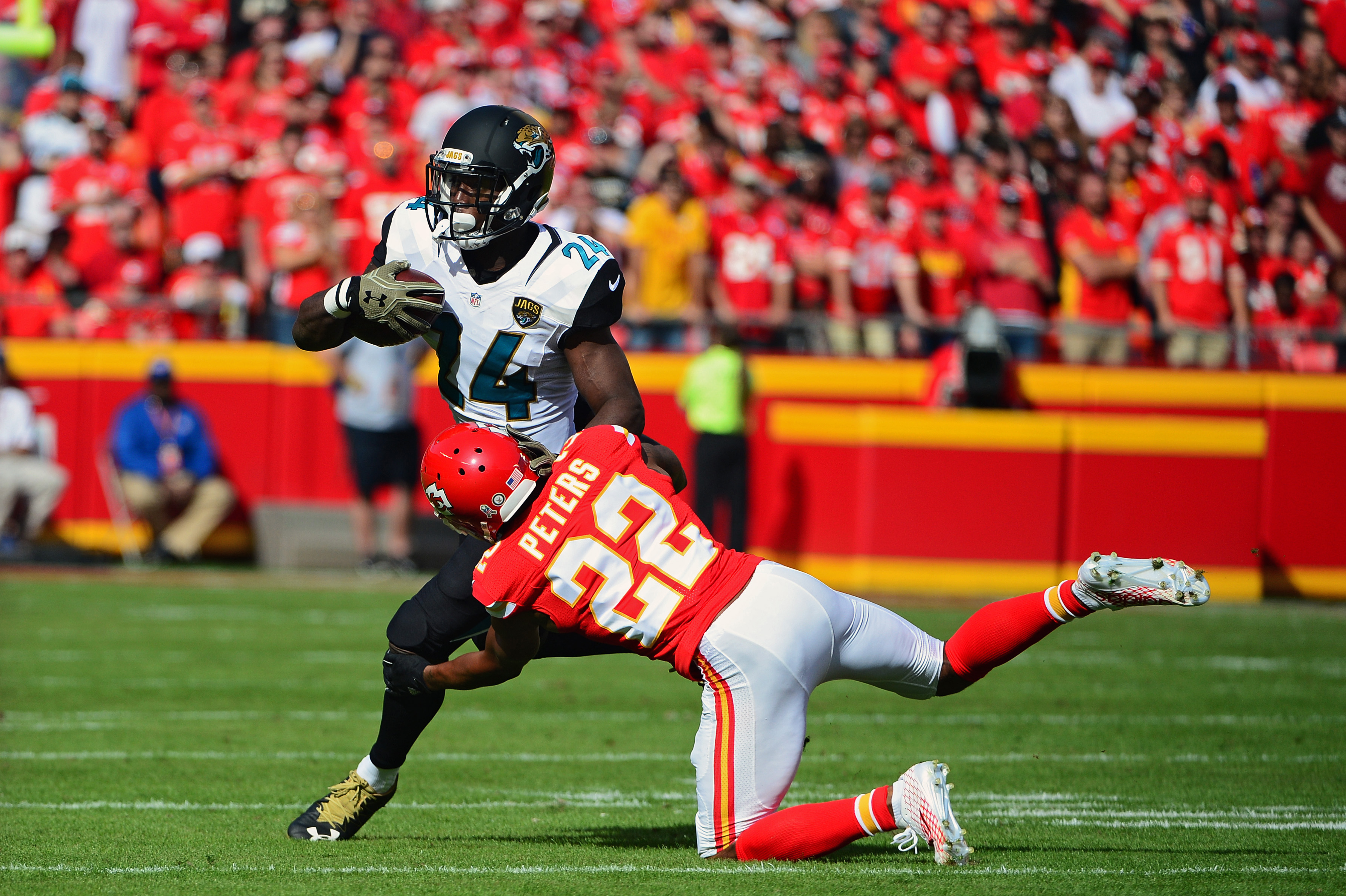Nov 6, 2016; Kansas City, MO, USA; Jacksonville Jaguars running back T.J. Yeldon (24) is tackled by Kansas City Chiefs cornerback Marcus Peters (22) during the first half at Arrowhead Stadium. Mandatory Credit: Jeff Curry-USA TODAY Sports