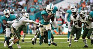 Nov 6, 2016; Miami Gardens, FL, USA; Miami Dolphins running back Jay Ajayi (23) carries the ball past New York Jets cornerback Buster Skrine (41) during the second half at Hard Rock Stadium. The Dolphins won 27-23. Mandatory Credit: Steve Mitchell-USA TODAY Sports