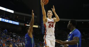 Nov 11, 2016; Jacksonville, FL, USA; Florida Gators guard Canyon Barry (24) goes up for a shot in the second half as Florida Gulf Coast Eagles guard Rayjon Tucker (3) and forward Kevin Mickle (10) defends at Jacksonville Veterans Memorial Arena. Florida Gators 80-59. Mandatory Credit: Logan Bowles-USA TODAY Sports