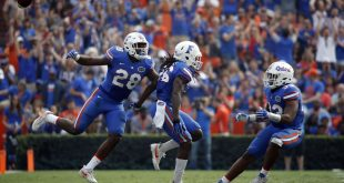 Nov 12, 2016; Gainesville, FL, USA;  Florida Gators defensive back Marcell Harris (26) is congratulated after he intercepted the ball against the South Carolina Gamecocks during the second half at Ben Hill Griffin Stadium. Florida Gators defeated the South Carolina Gamecocks 20-7. Mandatory Credit: Kim Klement-USA TODAY Sports