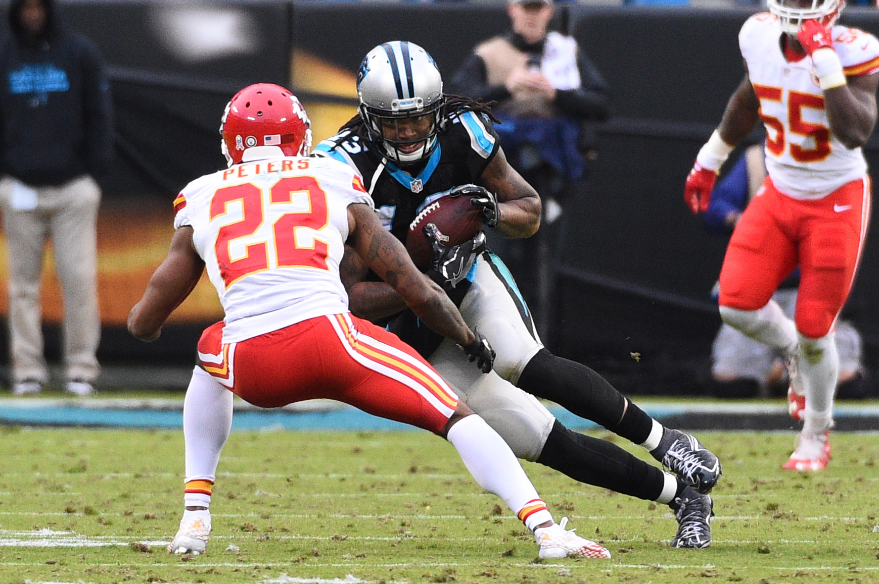 Nov 13, 2016; Charlotte, NC, USA; Carolina Panthers wide receiver Kelvin Benjamin (13) before being stripped of the ball by Kansas City Chiefs cornerback Marcus Peters (22) with 29 seconds left in the fourth quarter. The Chiefs defeated the Panthers 20-17 at Bank of America Stadium. Mandatory Credit: Bob Donnan-USA TODAY Sports