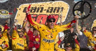 Nov 13, 2016; Avondale, AZ, USA; Sprint Cup Series driver Joey Logano (22) celebrates winning the Can-Am 500 at Phoenix International Raceway. Mandatory Credit: Jerome Miron-USA TODAY Sports
