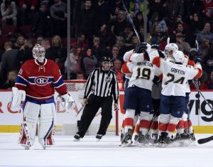 Nov 15, 2016; Montreal, Quebec, CAN; Florida Panthers defenseman Aaron Ekblad (5) reacts with teammates including Jussi Jokinen (36) after scoring the game winning a goal against Montreal Canadiens goalie Carey Price (31) during the overtime period at the Bell Centre. Mandatory Credit: Eric Bolte-USA TODAY Sports