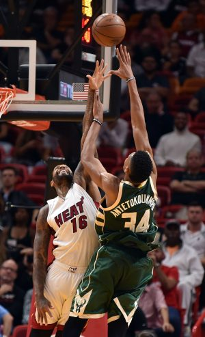 Nov 17, 2016; Miami, FL, USA; Miami Heat forward James Johnson (16) blocks a shot from Milwaukee Bucks forward Giannis Antetokounmpo (34) during the second half at American Airlines Arena. The Heat won 96-73. Mandatory Credit: Steve Mitchell-USA TODAY Sports