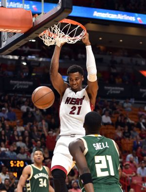 Nov 17, 2016; Miami, FL, USA; Miami Heat center Hassan Whiteside (21) dunks the ball against Milwaukee Bucks guard Tony Snell (21) during the second half at American Airlines Arena. The Heat won 96-73. Mandatory Credit: Steve Mitchell-USA TODAY Sports