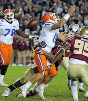 Nov 26, 2016; Tallahassee, FL, USA; Florida State Seminoles defensive tackle Derrick Nnadi (91) forces a fumble on Florida Gators quarterback Austin Appleby (12) during the second half of the game at Doak Campbell Stadium. Mandatory Credit: Melina Vastola-USA TODAY Sports