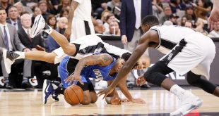 Nov 29, 2016; San Antonio, TX, USA; San Antonio Spurs point guard Tony Parker (9, behind) and center Dewayne Dedmon (3, front) battle for a loose ball on the floor with Orlando Magic point guard Elfrid Payton (4) during the second half at AT&T Center. Mandatory Credit: Soobum Im-USA TODAY Sports