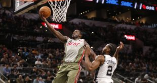 Nov 14, 2016; San Antonio, TX, USA; Miami Heat shooting guard Dion Waiters (11) shoots the ball past San Antonio Spurs small forward Kawhi Leonard (2) during the second half at AT&T Center. Mandatory Credit: Soobum Im-USA TODAY Sports