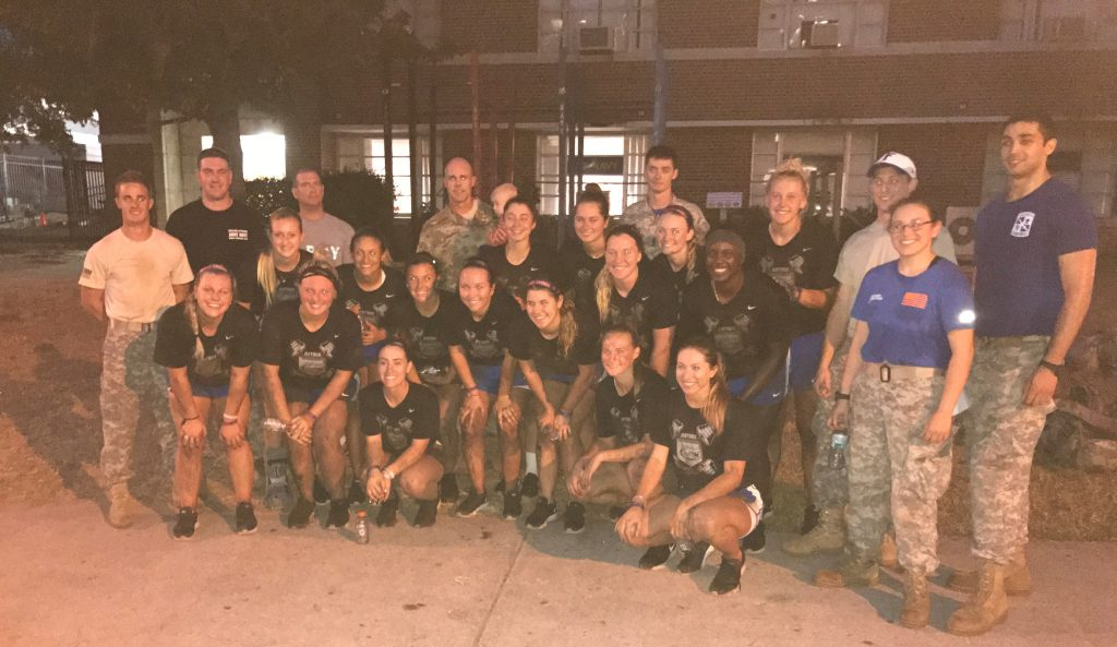 The Florida Softball team with the Army ROTC program after completion of the FLRC event.