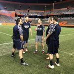 Kappa Phi QB Austin Riddaugh talks with teammates prior to kick-off at The Flag Football Championship in The Swamp. December 5, 2016 Photo Credit: Thomas DiBenedetto