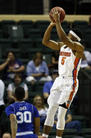 Nov 24, 2016; Kissimmee, FL, USA; Florida Gators guard KeVaughn Allen (5) shoots a jump shot against the Seton Hall Pirates during the first half at HP Field House. Mandatory Credit: Kim Klement-USA TODAY Sports