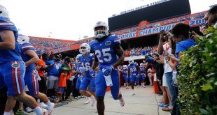 Nov 12, 2016; Gainesville, FL, USA; Florida Gators running back Jordan Scarlett (25) and teammates runs out of the tunnel before the game against the South Carolina Gamecocks and at Ben Hill Griffin Stadium. Mandatory Credit: Kim Klement-USA TODAY Sports