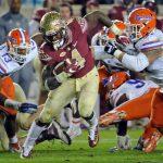 Florida State Seminoles running back Dalvin Cook (4) runs the ball past Florida Gators defenders ---Melina Vastola-USA TODAY