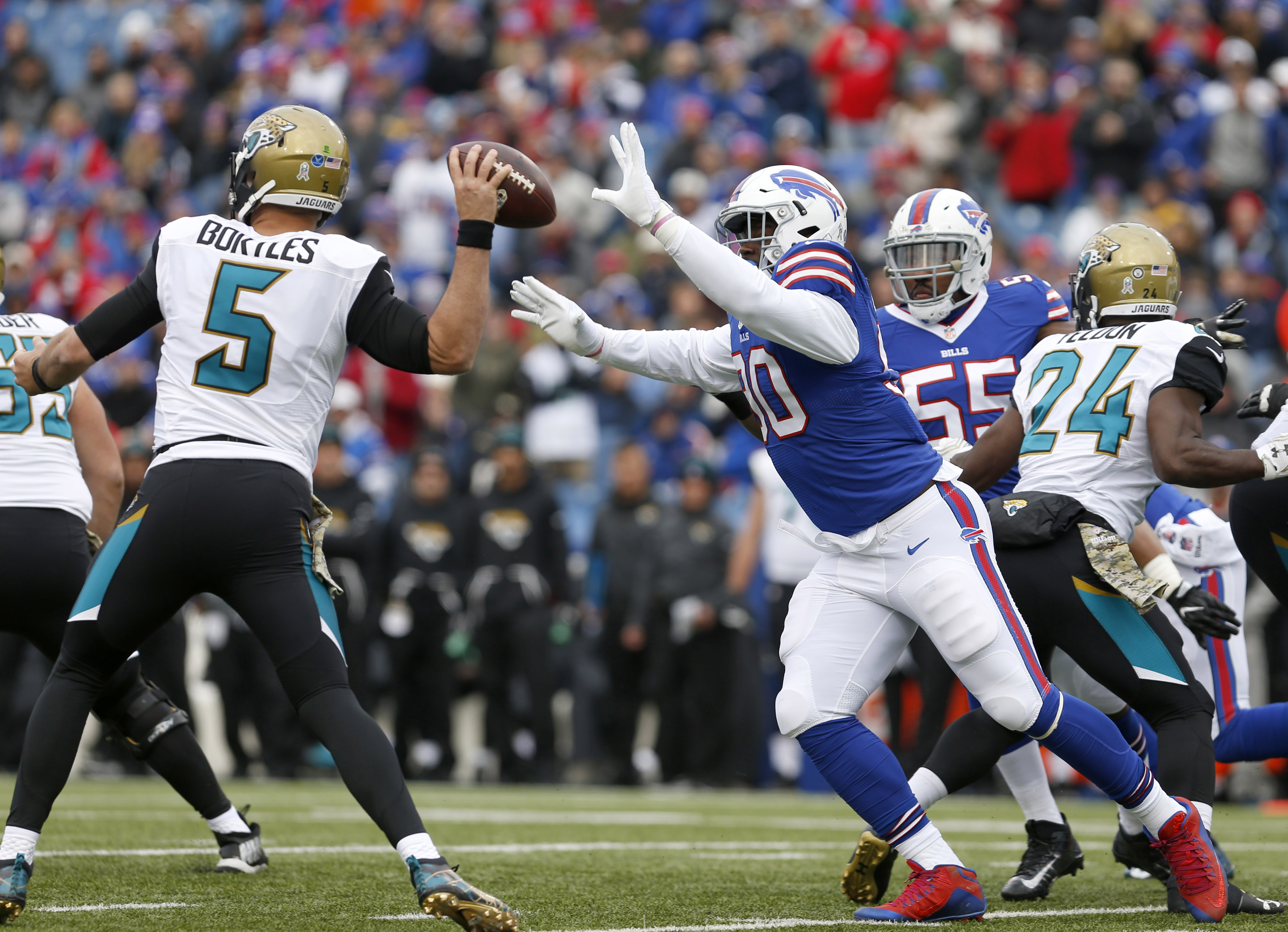 Nov 27, 2016; Orchard Park, NY, USA; Buffalo Bills defensive end Shaq Lawson (90) looks to knock the ball away from Jacksonville Jaguars quarterback Blake Bortles (5) during the first half at New Era Field. Mandatory Credit: Timothy T. Ludwig-USA TODAY Sports