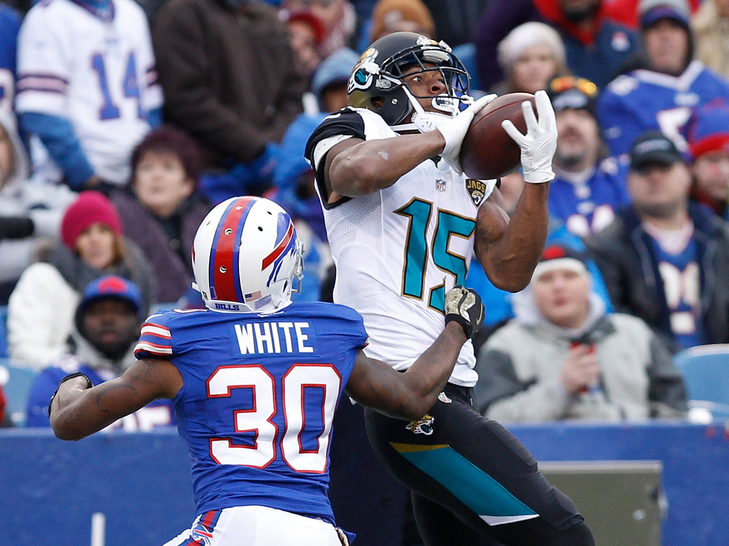 Nov 27, 2016; Orchard Park, NY, USA; Jacksonville Jaguars wide receiver Allen Robinson (15) catches a pass as Buffalo Bills cornerback Corey White (30) defends during the second half at New Era Field. The Bills won 28-21. Mandatory Credit: Kevin Hoffman-USA TODAY Sports