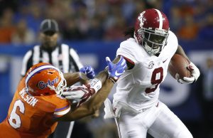 Dec 3, 2016; Atlanta, GA, USA; Alabama Crimson Tide running back Bo Scarbrough (9) runs the ball against Florida Gators defensive back Quincy Wilson (6) during the second quarter of the SEC Championship college football game at Georgia Dome. Mandatory Credit: Brett Davis-USA TODAY Sports