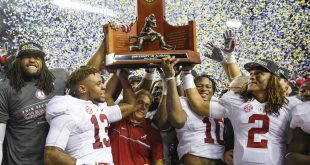 Dec 3, 2016; Atlanta, GA, USA; Alabama Crimson Tide head coach Nick Saban celebrates winning the trophy with his team after the SEC Championship college football game against the Florida Gators at Georgia Dome. Alabama defeated Florida 54-16. Mandatory Credit: Jason Getz-USA TODAY Sports