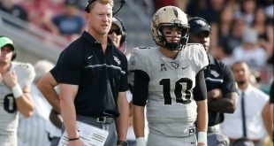 Nov 26, 2016; Tampa, FL, USA; UCF Knights head coach Scott Frost and quarterback McKenzie Milton (10) talk on the sidelines against the South Florida Bulls during the second half at Raymond James Stadium. South Florida Bulls defeated the UCF Knights 48-31. Mandatory Credit: Kim Klement-USA TODAY Sports
