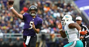 Dec 4, 2016; Baltimore, MD, USA;  Baltimore Ravens quarterback Joe Flacco (5) throws as Miami Dolphins center Mike Pouncey (51) applies pressure during the first quarter at M&T Bank Stadium. Mandatory Credit: Tommy Gilligan-USA TODAY Sports