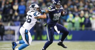 Dec 4, 2016; Seattle, WA, USA; Seattle Seahawks tight end Jimmy Graham (88) stiff arms away from a tackle by Carolina Panthers outside linebacker A.J. Klein (56) during the second quarter at CenturyLink Field. Seattle defeated Carolina, 40-7.  Mandatory Credit: Joe Nicholson-USA TODAY Sports