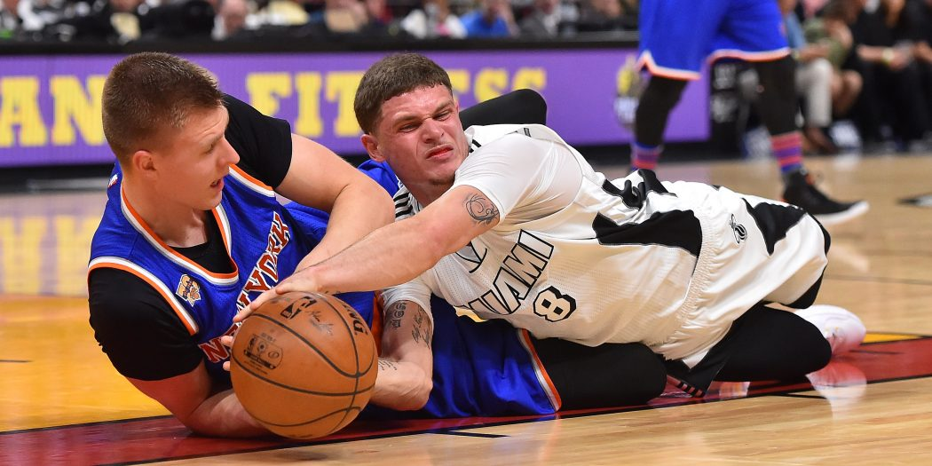 Dec 6, 2016; Miami, FL, USA;  New York Knicks forward Kristaps Porzingis (6) and Miami Heat guard Tyler Johnson (8) fight for control of the ball during the first half at American Airlines Arena. Mandatory Credit: Jasen Vinlove-USA TODAY Sports